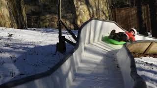 Tucker West on backyard luge track
