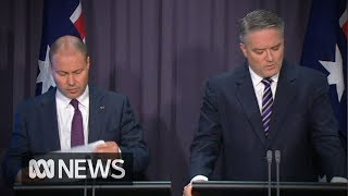Australia's budget deficit slashed, with surplus forecast for next year | ABC News