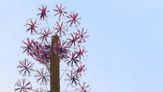 Low angle shot of rotating colorful pinwheels for sale in the market of Kumbh Mela, India