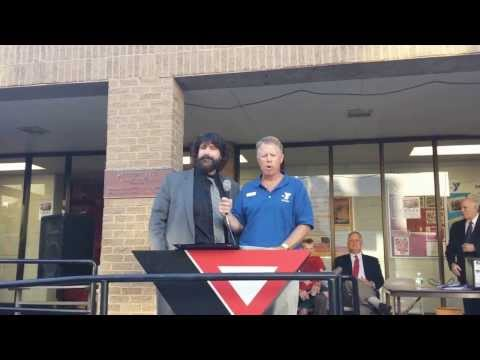 """World Wrestling Entertainment wrestler Mick Foley and Westport Weston Family Y CEO Rob Reeves lead the singing of """"Happy Birthday"""" during the Y's 90th birthday celebration Wednesday."""