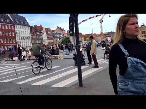 Cycling in Copenhagen during art music festival, inner town Nyhavn - September 2017