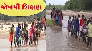 Students reaching school by crossing the river at the risk