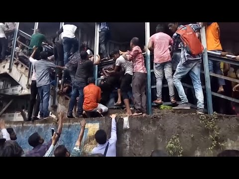 Mumbai stampede: at least 22 killed in fatal rush-hour crush – video report