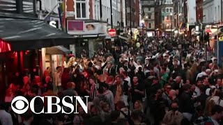 People in England flock to pubs, bars and restaurants as they reopen