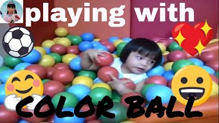 Children are playing with colored balls