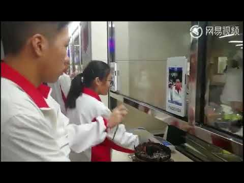 Student in HangZhou China use Face Scan to get Food