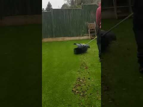 Artificial Grass power brush in action