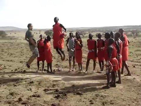 Jumping against a Maasai Warrior