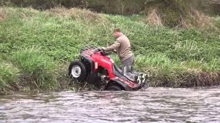 honda bigred 300 in the river