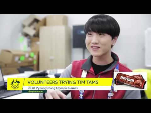 Korean volunteers try Tim Tams