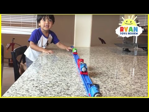 Thomas and Friends kid playing with trains around the house