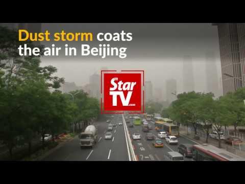 Dust storm envelops Beijing
