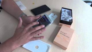 Распаковка трехсимочного телефона HTM H9503