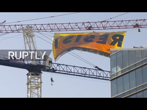 LIVE: Greenpeace activists climb crane in D.C. in protest against Trump