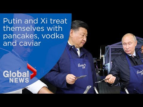 Vladimir Putin and Xi Jinping treat themselves with pancakes, vodka and caviar