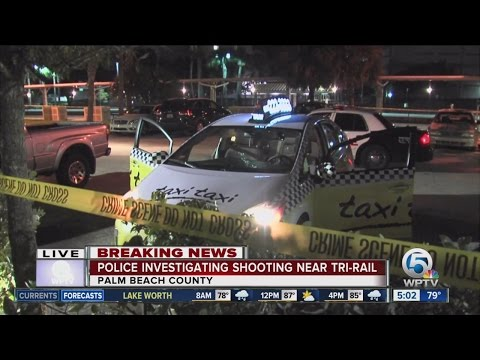Taxi cab hit by bullets near West Palm Beach Tri-Rail station