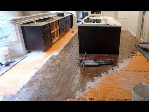How to install floor tile around a Kitchen Island with wood look plank tile