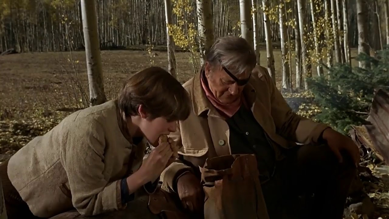 Download True Grit 1969 Texas waddies drinking out of a hoofprint