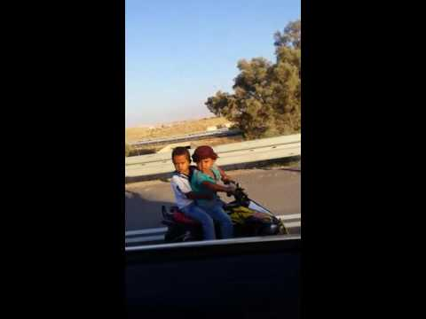 Bedouin Children Driving on the Highway