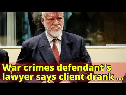 War crimes defendant's lawyer says client drank poison