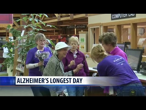 Touchmark gives out carnations to raise Alzheimer's Awareness on 'Longest Day' in Helena