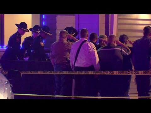 Slain deputies honored as bodies removed from restaurant