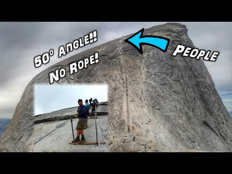 Climbing a 50º Angle Smooth Rock Face with Only Cables.  Half Dome, Yosemite National Park