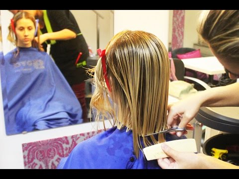 Lovely blonde girl getting a renewed sexy bob haircut