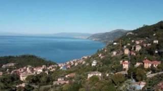 La città di Genova e la costa del ponente ligure viste dal monte di Portofino