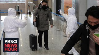 Amid coronavirus outbreak, Wuhan residents confront fear, government distrust