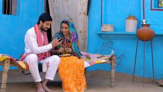 Young attractive husband showing new things to his beautiful wife on his new smartphone - Village life