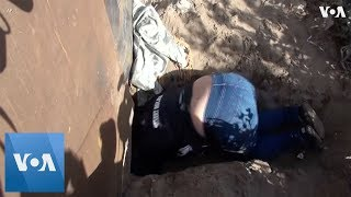 US Border Agents Stop Woman Squeezing Under Fence