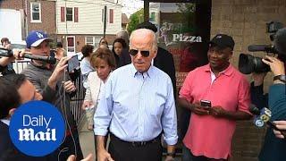 Joe Biden greets his supporters outside Delaware pizza shop