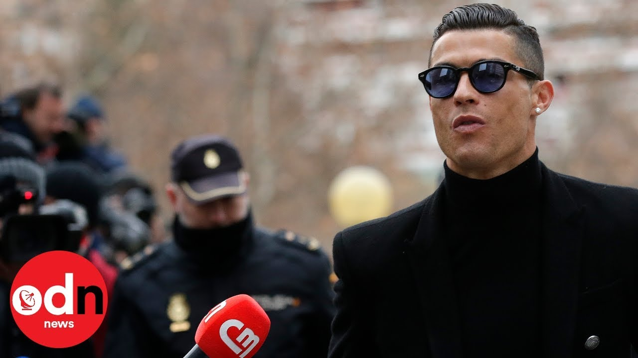 Cristiano Ronaldo arrives at court in Madrid with girlfriend Georgina Rodriguez