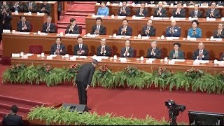 CPPCC members rise for China's national anthem as annual meet ends