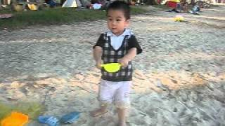Baby dancing by the sea with Indian music 2010