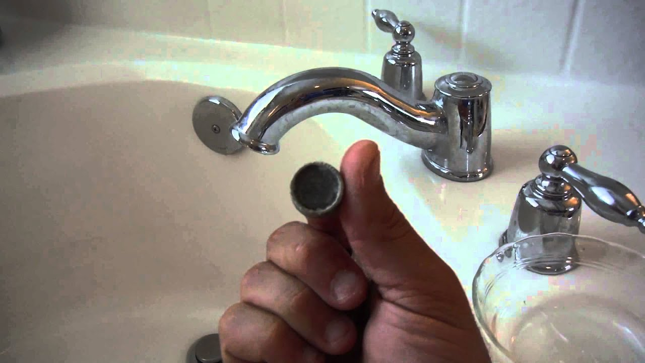 plugged bathtub faucet low water pressure cleaning the aerator screen