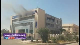 شاهد اللقطات الأولى لتصاعد الدخان من فرع البنك التجارى الدولى بالعاشر من رمضان