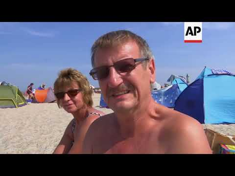 People In Germany Flock To Baltic Sea Coast During Scorching Heat
