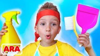 يلعب كل من فلاد و نيكيتا بأدوات التنظيف حيث يلهوان ويساعدان والدتهما