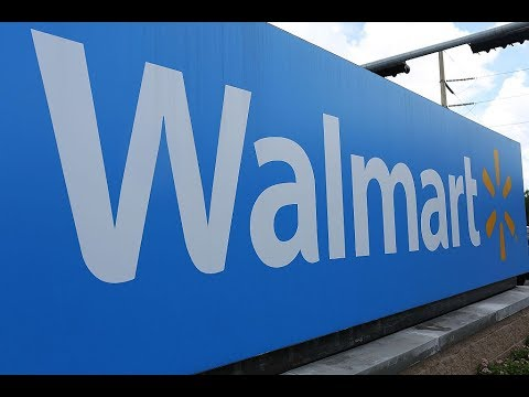Walmart raises hourly wages, handing out $1K bonuses
