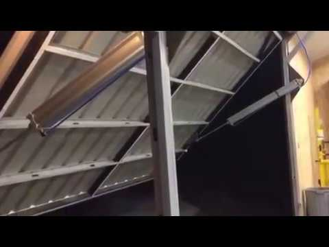 Pneumatic hanger style garage door & Pneumatic hanger style garage door - YouTube