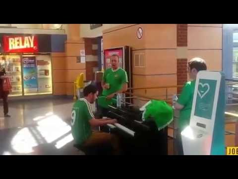 Three Irish fans perform beautiful 'Fields of Athenry' in French train station