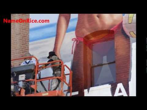 NEW SEXY ADVERTISING BEING PAINTED ON WALL VENICE BEACH CALIF. JAN 12, 2012