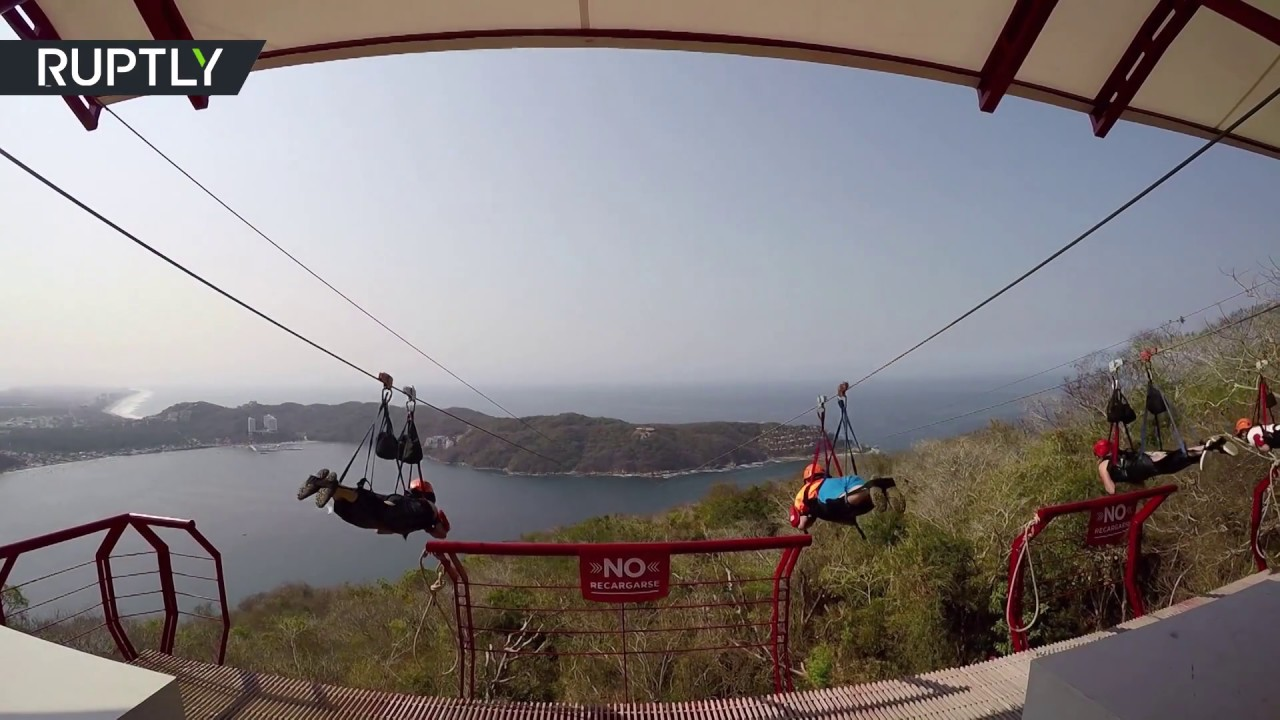 Head-spinning ride on an over-water zip line - probably longest in ...