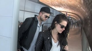 """Kristen Stewart """"in love"""" with Robert Pattinson at Charles de Gaulle airport heading back to LA"""