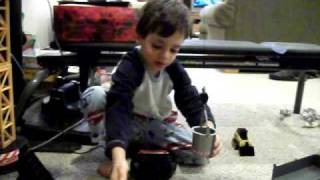 lucas with new tonka garbage truck and remote control mega crane