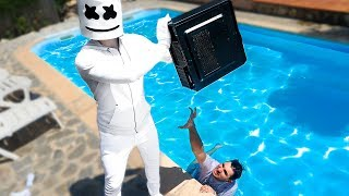 MARSHMELLO TIRATE MY +1,700-DEGREE PC TO THE POOL *Fortnite in real life*