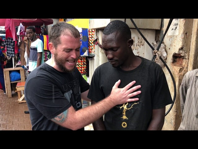 Preaching repentance in the rain in downtown Kampala, Uganda