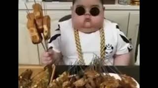Fat & cute Chinese kid - eating